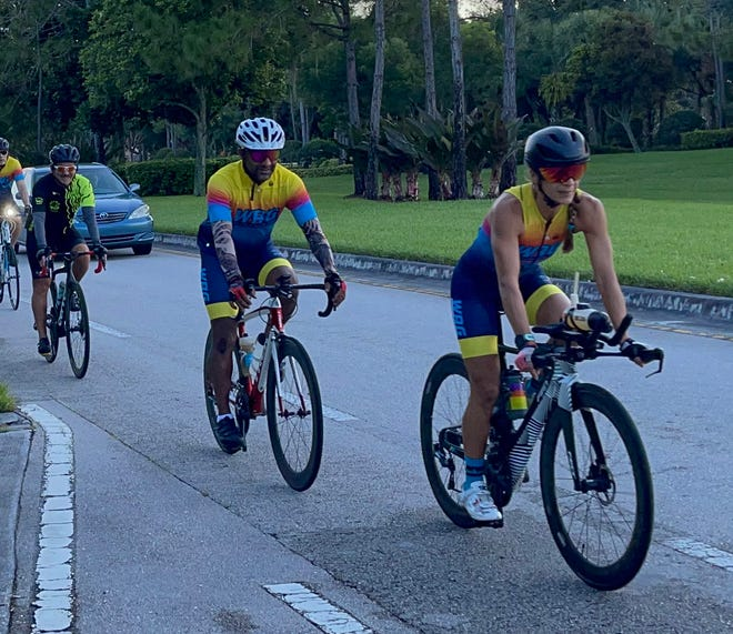 A group of bicyclists heads south on Lyons Road from Boynton Beach to Delray Beach.