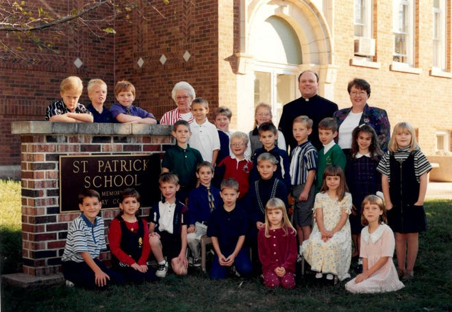 A class photo is taken outside St. Patrick School. The school will kick off its centennial celebration with two days of activities on July 23-24.