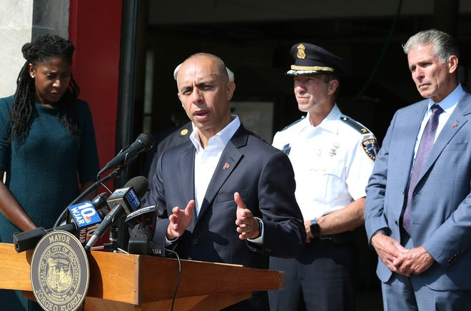 Providence Mayor Jorge Elorza provides an update on the city's plans for a crisis response team. Behind him, from left, are Councilwoman Nirva LaFortune, Police Chief Hugh Clements Jr. and Public Safety Commissioner Steven Paré.