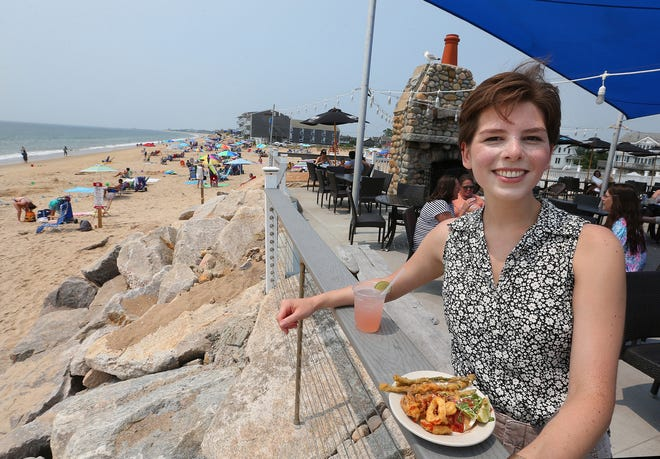 Amy Russo enjoys the seafood and the view at The Andrea in Misquamicut, one stop in her five-hour food tour of Westerly.