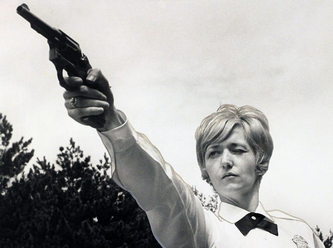 With a steady aim, Providence police officer Patricia Lamont eyes a target with her .38-caliber service revolver in 1966.