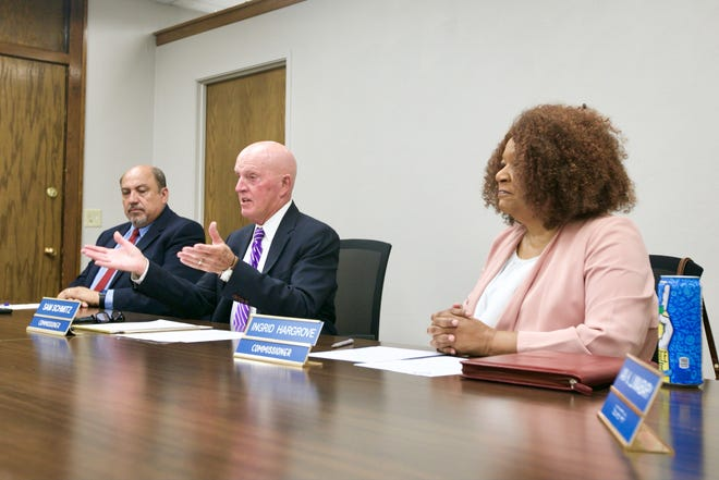 The Rockford Board of Fire and Police Commissioners announces four finalists each for the city's chief of police and fire departments during a news conference on Thursday, July 22, 2021, in Rockford. From left to right are commissioners Rudy Valdez, Sam Schmitz and Ingrid Hargrove.