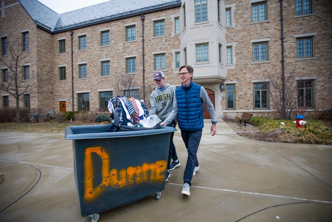 Riley and his father James McNulty move the sophomore's belongings to their car on March 16, near Dunne Hall on the campus of the University of Notre Dame.