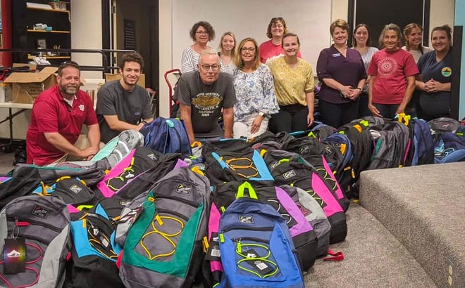 Volunteers gather to fill backpacks with supplies for the 2021 Back-to-School Expo to be held at the Owen County Fairgrounds on Saturday, July 24.