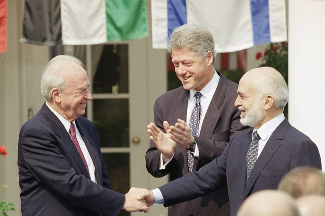 President Clinton looks on as Israeli Prime Minister Yitzhak Rabin, left, shakes hands with King Hussein of Jordan at the White House on July 25, 1994, prior to the start of peace talks. The two leaders were ready to sign a declaration that was aimed at ending years of belligerency between the two countries as well as provide a blueprint for economic cooperation.