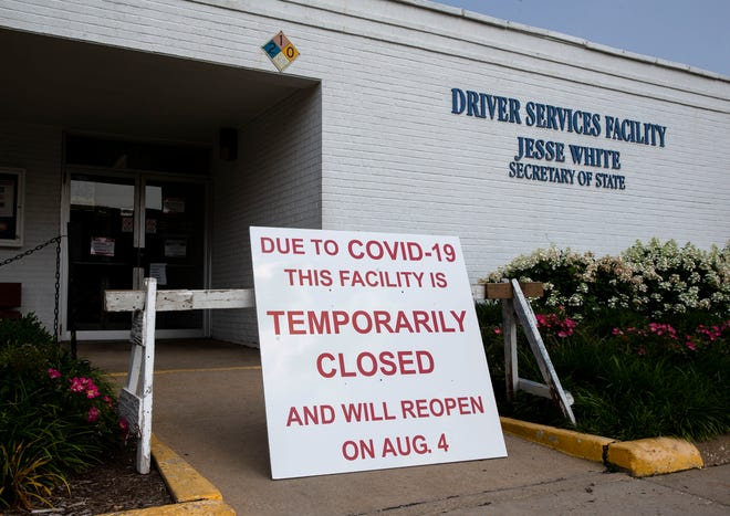 A sign was placed outside the Illinois Secretary of State Driver's Services facility at 316 N. Klein St. stating the facility is temporarily closed until Aug. 4th because of COVID-19 in Springfield, Ill., Thursday, July 22, 2021. [Justin L. Fowler/The State Journal-Register]