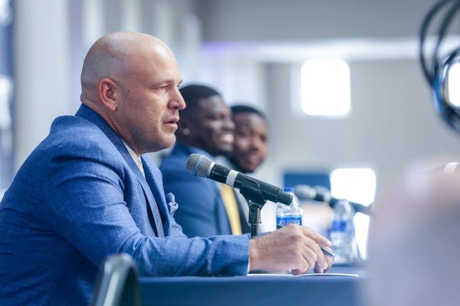 Georgia Southern football coach Chad Lunsford speaks while, to his left, linebacker Todd Bradley-Glenn and running back J.D. King listen during the Sun Belt Conference Football Media Day on Thursday, July 22, in New Orleans.