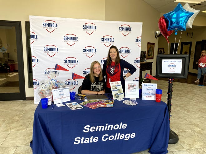 Seminole State College sophomore Jenna Harrison (left), of Tecumseh, and Recruitment Specialist Britney Honsinger (right) greet perspective students during the college's Reach Higher Reconnect Week.