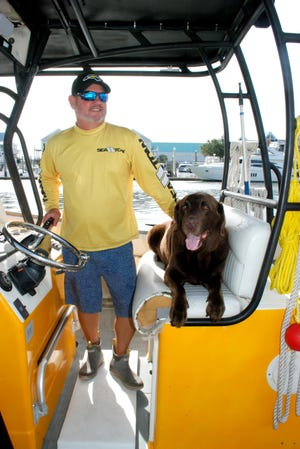 Sea Tow Captain Scott Collins with his dog.