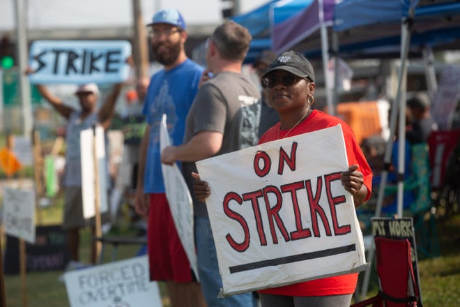 Kym Lewis, a Frito-Lay employee of three years, stands on the strike line Thursday morning across from the company's Topeka plant, 4236 S.W. Kirklawn Ave.