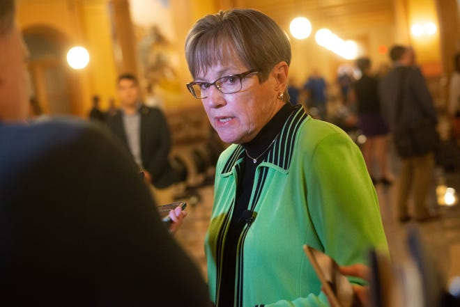 Gov. Laura Kelly talks with members of the media Thursday at a Statehouse event. Kelly said the state won't pull out of expanded federal unemployment programs, a move she said earlier this year she was considering.