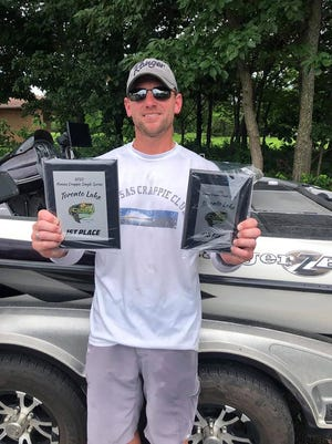 Topeka's Dustin Hobbs holds up his first-place and big-fish plaques after winning the Kansas Crappie Trail singles event July 17 on Toronto Reservoir.