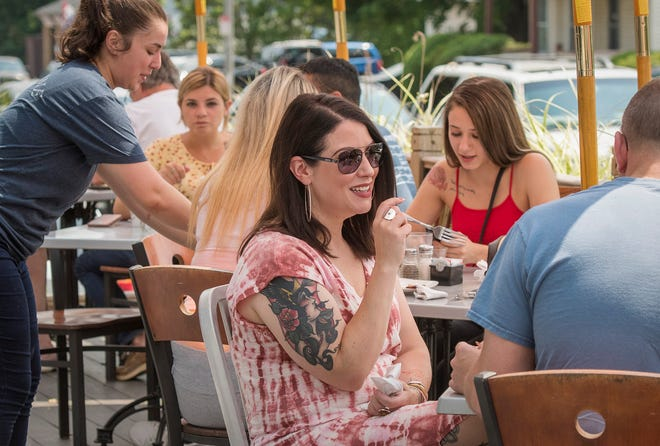 Kendra Cox of Worcester dines with a group on the outdoor patio at Livia's Dish Thursday.