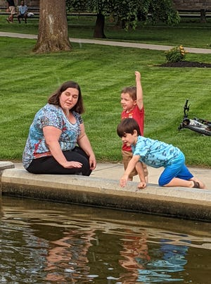 Laura Garrity-Arquitt, of Clinton, and her son, Cyrus Arquitt (center), 4, along with friend Elias Silva, 4, of Clinton, check out the Foster Fountain in Central Park Tuesday, July 20.