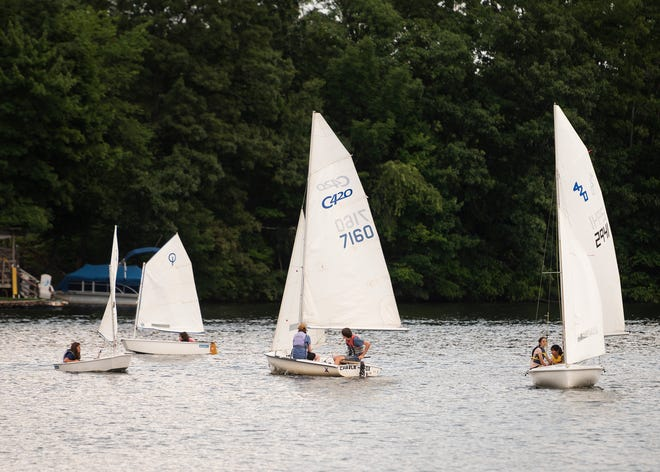 Sailboaters enjoy the warm temperatures on Lake Quinsigamond on Thursday.