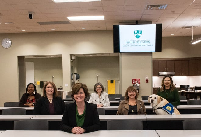 Dr. Jennifer Moore, dean of The Arkansas Colleges of Health Education School of Occupational Therapy, is shown with some of the faculty and staff.