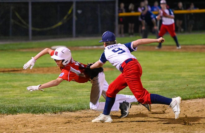 Quinn Bakst of Reading is tagged out by Owen Hawke of Danvers American after trying to make it back to first base during the State Section 4 Williamsport Little League tournament game at Harry Ball Field in Beverly on Wednesday, July 21, 2021.