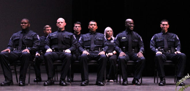 Some of the seven Abilene Police Academy cadets smile during a lighter moment at Thursday's graduation ceremony at the Abilene Convention Center.
