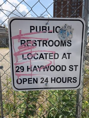 """This sign at 68 Haywood Street, the infamous """"Pit of Despair"""" site, is out of date. The restrooms at 29 Haywood St. are closed."""