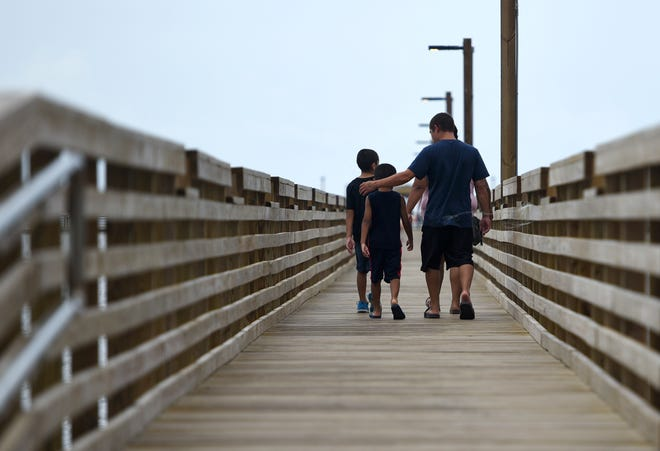 People fish on the new Fulton Fishing Pier, Thursday, July 22,, 2021, in Rockport. The pier was rebuilt after being destroyed by Hurricane Harvey in 2017.