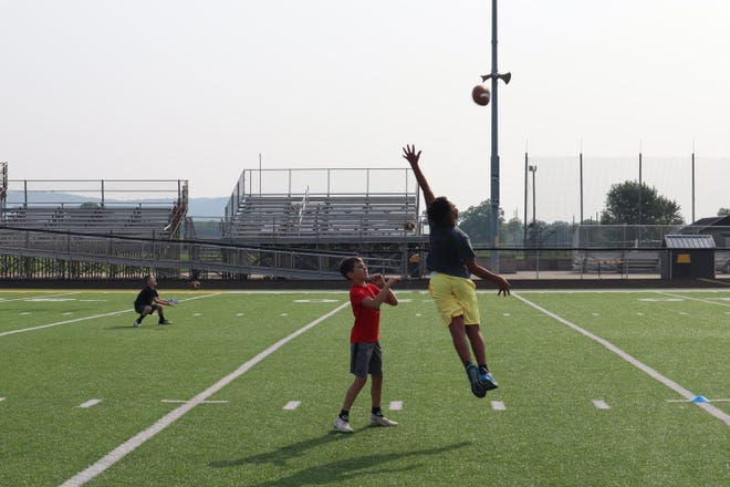"""""""Future Bearcats"""" playing catch ahead of the start of camp."""