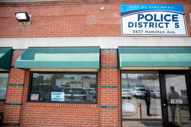 A view of the front entrance and only sign of Cincinnati Police District 5 in a strip mall in College Hill on Thursday, July 22, 2021.