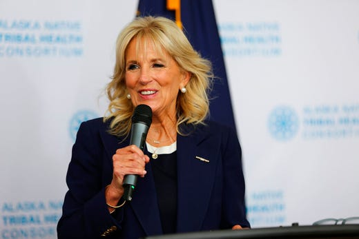 First lady Jill Biden addresses reporters during a visit, Wednesday, July 21, 2021, to the Alaska Native Health Tribal Health Consortium office in Anchorage, Alaska. Biden stopped in Alaska's largest city as she traveled to Tokyo, her first solo international trip as first lady, leading a U.S. delegation to the Olympic Games. (AP Photo/Mark Thiessen)