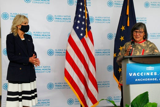 Val Davidson, right, the president of the Alaska Native Health Tribal Health Consortium, introduces first lady Jill Biden, left, during a visit Wednesday, July 21, 2021, to the consortium office in Anchorage, Alaska. Biden stopped in Alaska's largest city as she traveled to Tokyo, her first solo international trip as first lady, leading a U.S. delegation to the Olympic Games. (AP Photo/Mark Thiessen)