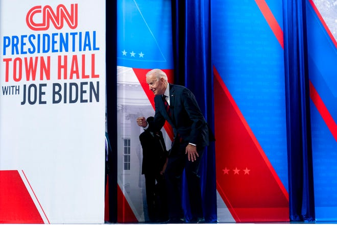 President Joe Biden interacts with members of the audience during a commercial break for a CNN town hall at Mount St. Joseph University in Cincinnati, Wednesday, July 21, 2021. (AP Photo/Andrew Harnik)
