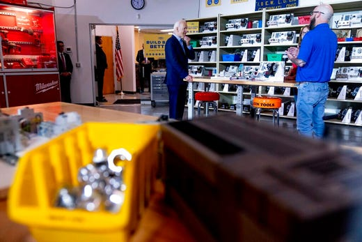 President Joe Biden meets with instructor Dan McCarthy, right, in a classroom at the IBEW / NECA Electrical Training Center in Cincinnati, Wednesday, July 21, 2021. (AP Photo/Andrew Harnik)