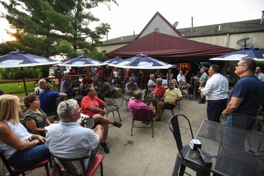 Hamilton County Chairman of the Republican Party, Alex Triantafilou speaks to a crowd at Linnie's Pub in Delhi Township during President Biden's CNN Townhall, taking place nearby at Mount St. Joseph University.
