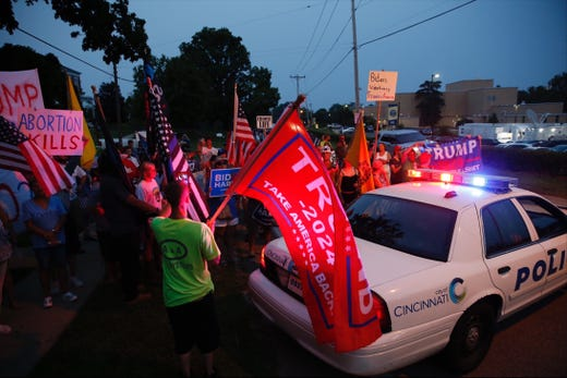 Demonstrators wait for President Biden to leave after finishing the town hall.
