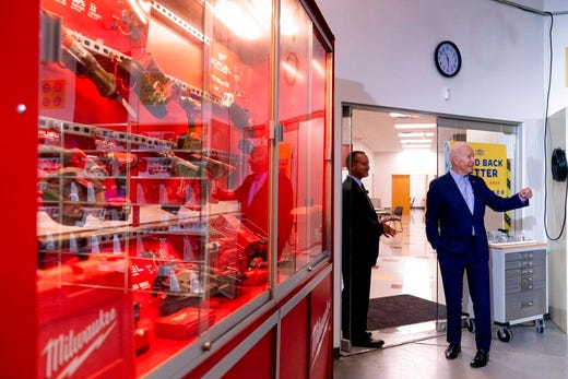 President Joe Biden, right, accompanied by his tour guide Rick Fischer, left, speaks to members of the media as he leaves a classroom after meeting with an instructor and apprentice at the IBEW / NECA Electrical Training Center in Cincinnati, Wednesday, July 21, 2021. (AP Photo/Andrew Harnik)