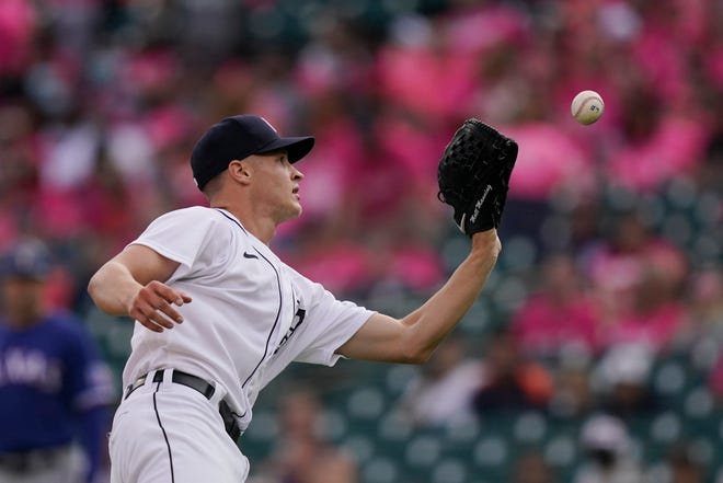Detroit Tigers starting pitcher Matt Manning catches the pop-up hit by Texas Rangers' Brock Holt during the first inning at Comerica Park in Detroit on Wednesday, July 21, 2021.