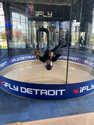 Kenneth Duke, one of the flight instructors at iFLY in Novi, shows off his indoor skydiving skills on Thursday, July 22, 2021.