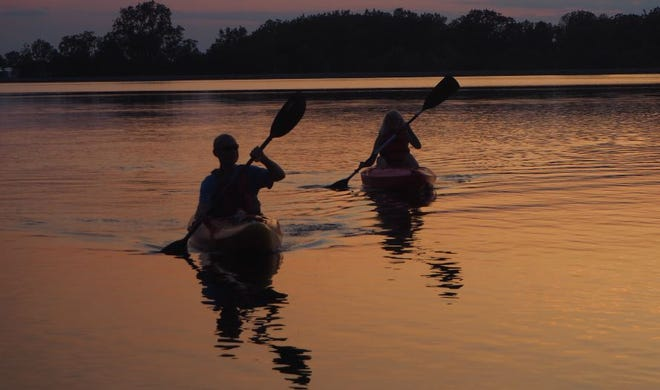 Kayakers taken in a sunset at the Fremont reservoir last week during Sunset on Res at Ghoul Runnings.