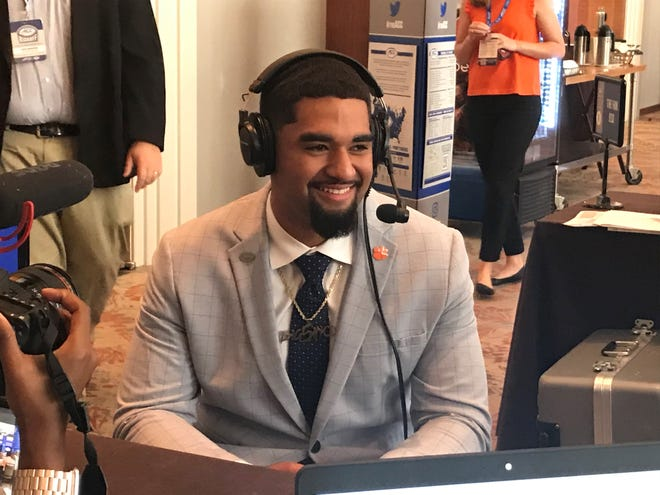 Clemson quarterback D.J. Uiagalelei, who announced a deal with Bojangles restaurants on Wednesday, participates in one of several radio interviews Thursday at the ACC Football Kickoff in Charlotte, N.C.