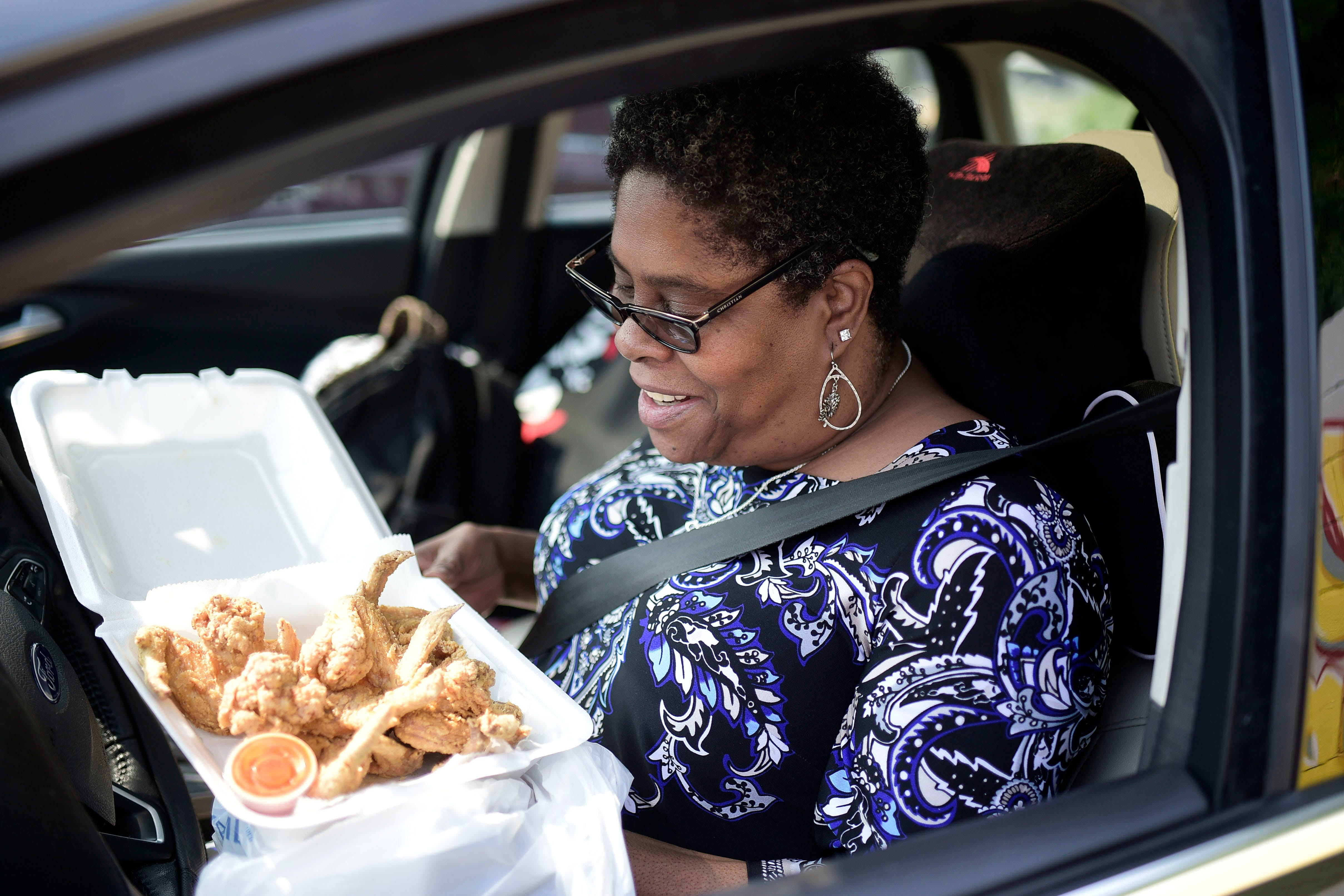 Pamela Harrison ordered 10 wings on this visit to Burger Boys restaurant. She typically orders 20 at a time. She sometimes skips breakfast to save room for the food, which she enjoys eating with hot sauce on the drive home.
