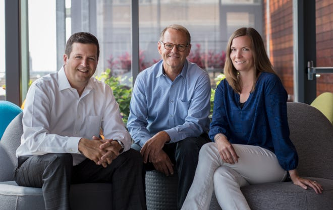 Eppstein Uhen Architects President Rich Tennessen (left) will succeed Greg Uhen (middle) as the firm's chief executive officer. Kristin Dufek will succeed Tennessen as president.