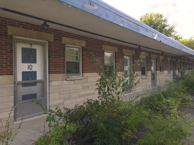 The Hilltop Motel, which is in disrepair and overrun with weeds, was in Delaware County's possession due to unpaid property taxes.