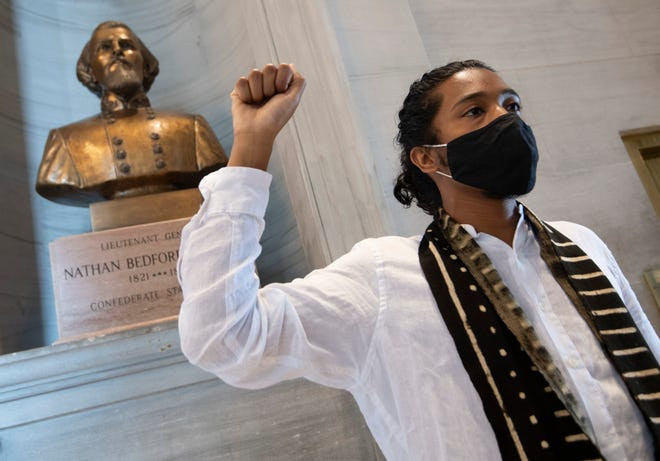 Activist Justin Jones raises his fist at the Nathan Bedford Forrest bust in the State Capitol Thursday, July 22, 2021 in Nashville, Tenn. after the removal of the bust was approved by the State Building Commission. Jones led protests over the summer of 2020 to have the bust removed. The State Building Commission on Thursday gave approval for the relocation of the Forrest bust to the Tennessee State Museum, a final step in a process that has taken more than a year since Gov. Bill Lee first said it was time for the statue to be moved.