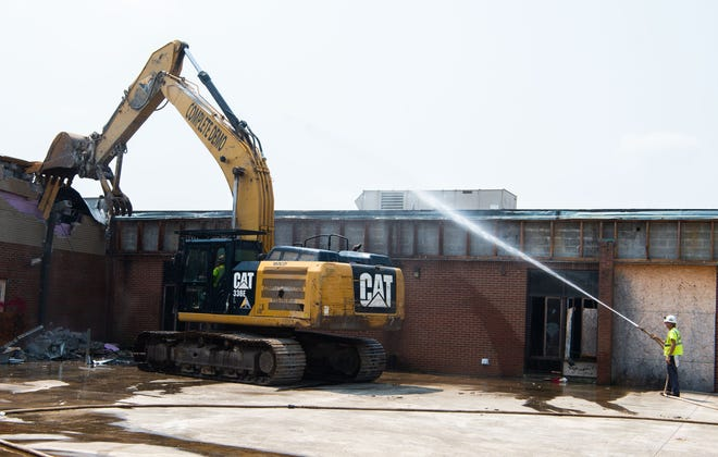 Demolition begins at the West Wilson Middle School in Mt. Juliet, Tenn., Thursday, July 22, 2021. The school was damaged from the tornado of March 2020.