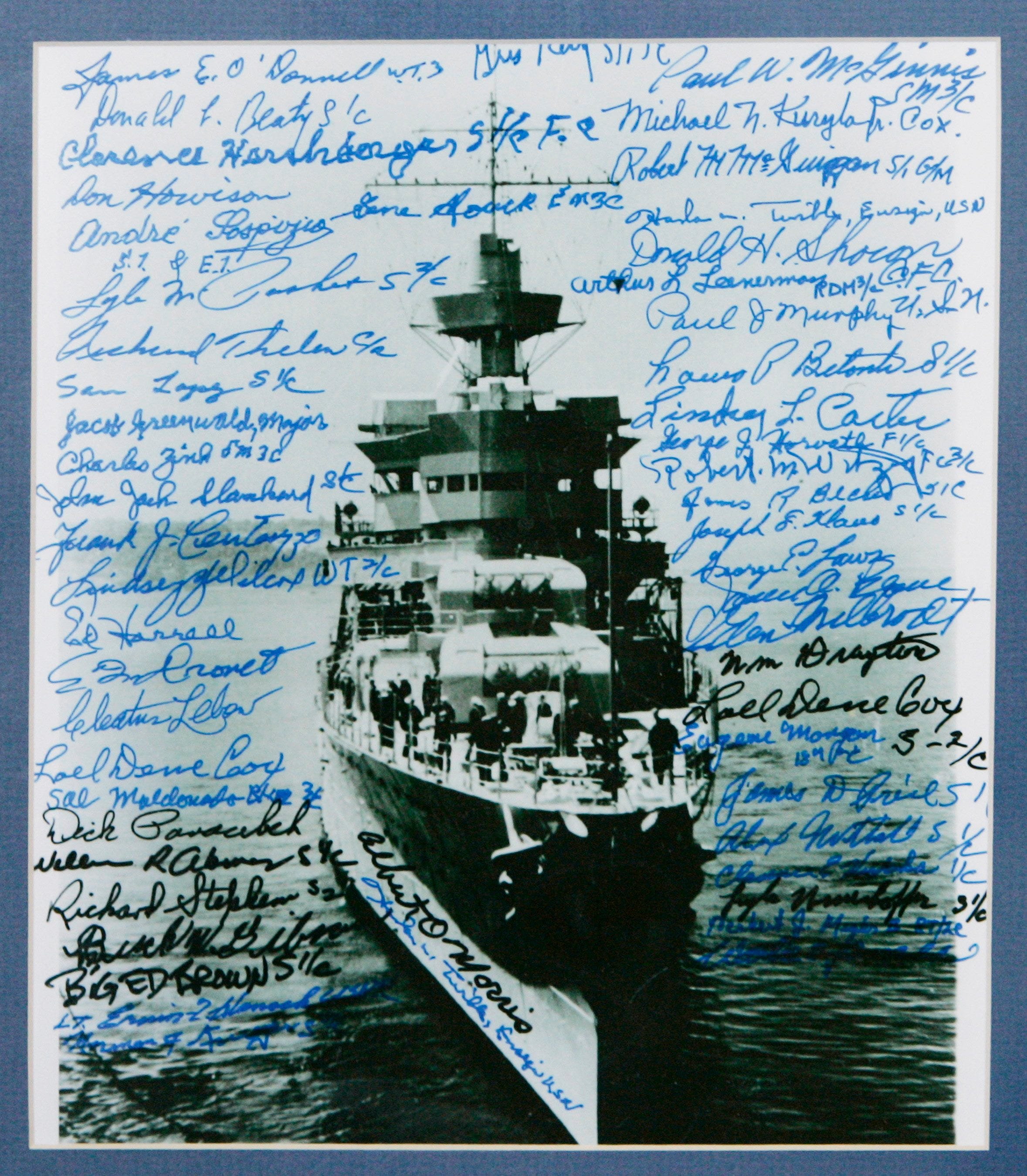 Signatures of survivors cover a photo of the USS Indianapolis at an exhibit in Indianapolis in 2007. The exhibit included letters and telegrams about the heavy cruiser's July 30, 1945, sinking by Japanese torpedoes.