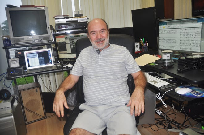 Alex Goldstein sits in his North Naples studio. It is here that he composes and puts together music for Olympic athletes.