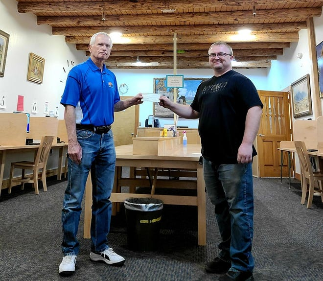 Gary Jeffreys, on behalf of the Mimbres Library Foundation Inc., presented a check for $12,717 to Lucas Marsh, director of the Marshall Memorial Library, to reimburse the City of Deming for the purchase of 18 new computers for the library's computer lab. The Mimbres Library Foundation Inc. is a 501©(3) charitable nonprofit corporation set up in 1955 to assist the library with its funding needs. The foundation is led by board members Jeffreys, DeeDee Baker, and Ann Chrestman. The foundation provided most of the funding for the furnishings in the library when it moved to its present location at 11 S. Diamond Avenue in 2005 and has been an important source of reimbursement to the city over the years for its various needs and projects. Donations to the foundation are welcomed and needed. They can be made by contacting Jeffreys at: P.O. Box 1607, Deming, NM 88031, or Lucas Marsh at the library.