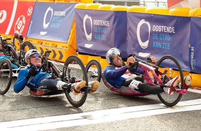 Ryan Pinney (right) races to the finish line at the 2021 World Championships in Belgium.
