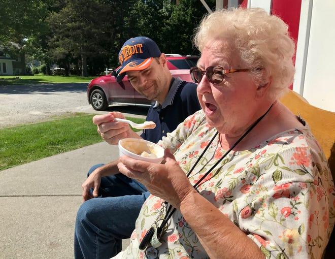 Port Huron resident RickGurnsey and his grandmother Marysville resident Lorna Dennison enjoy ice cream at Dairy Boy in Marysville on July 21, 2021.