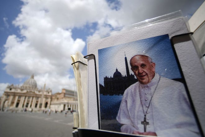A postcard showing Pope Francis is displayed at a souvenirs shop by St. Peter's Square in the Vatican on July 14, 2021.  (Filippo Monteforte/AFP via Getty Images/TNS)
