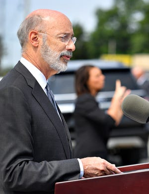 Gov. Tom Wolf, left, speaks as ASL Interpreter Kendra Barlet, with the Office for the Deaf & Hard of Hearing within the Pennsylvania Department of Labor & Industry, translates for viewers during a visit to Wolfgang Confectioners as plans for an expansion are announced in Loganville, Thursday, July 22, 2021. With $145,000 in grants from the Department of Community and Economic Development and a plan to invest $3.5 million into the project, the family-owned chocolate company will expand to 24-hour production and create 95 new jobs. Dawn J. Sagert photo