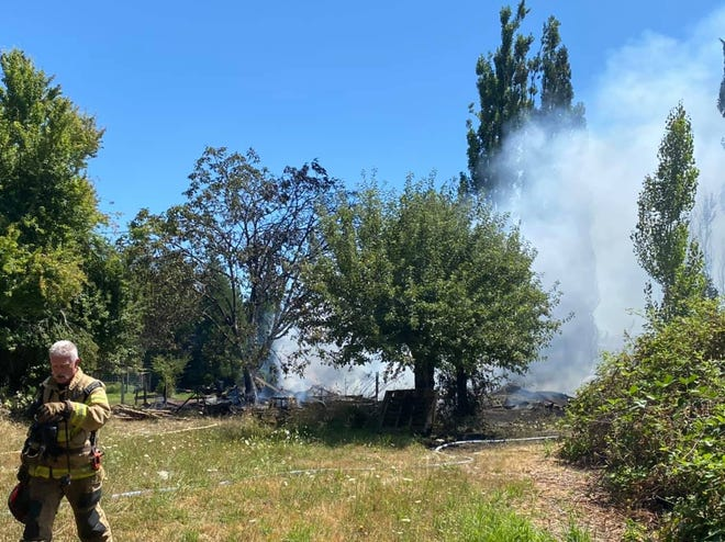 Crews extinguished a grass fire that demolished a barn Thursday afternoonoff Fruitland Road NE,east of Salem in Marion County.